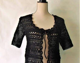 Vest black short sleeve crochet.