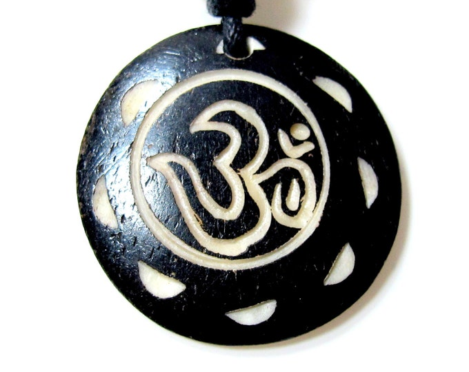 This is a round disc  shape OM  inscribed bone  pendant - PB036