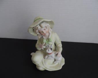 Vintage Bisque Porcelain Figurine Blonde Girl In Light Green Hat And Dress Sitting On Floor Holding Kitten   1642