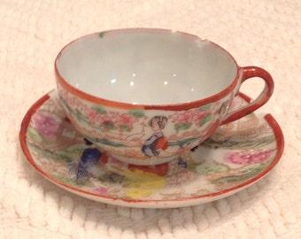 Vintage Japanese Kutani Ware hand painted teacup and saucer.