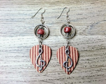 Guitar pick earrings and the treble clef