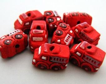 4 Tiny Fire Truck Beads - CB262