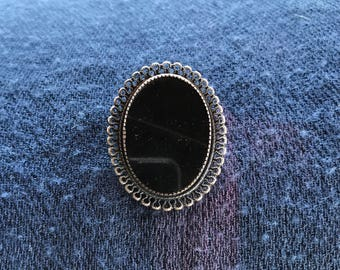 Onyx and silver broach