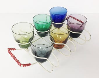 Vintage shot glasses in an atomic cream wire rack