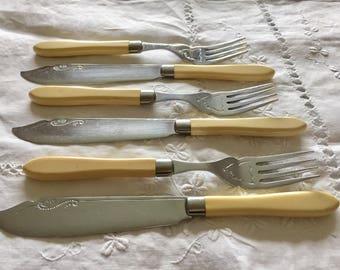 Vintage art nouveau fruit/butter knives and forks.