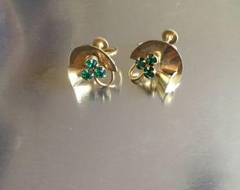 Yellow metal screw back earrings .