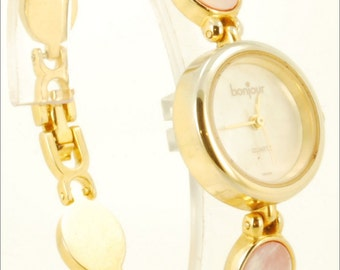 Bonjour quartz ladies vintage wrist watch, gold-toned & stainless steel round case, mother-of-pearl dial, matching band