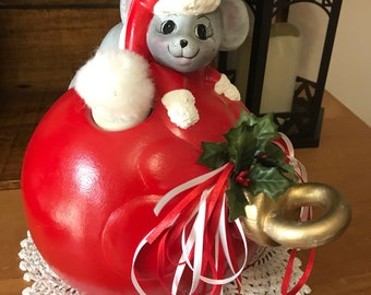 Large ceramic christmas bulb with mouse figurine, centerpiece.