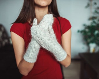 Woman knitted white mittens with rare kind of goat down(Don goat)