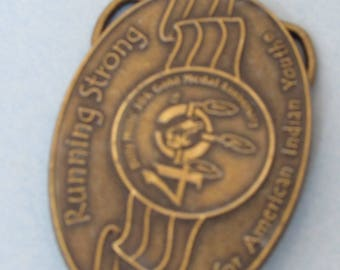 "Belt Buckle, 3 X 2 inches, ""Running Strong for American Indian Youth"