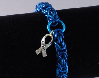 Blue Hope Ribbon bracelet Byzantine Chainmaille, silver tone ribbon charm, lobster clasp, blue anodized aluminum chainmail, cancer awareness