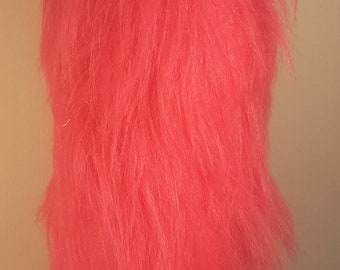 Bright pink fluffy cat tail.