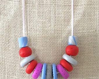 Red, pink and grey handmade polymer clay vegan necklace on 70cm polyester cord with breakaway clasp