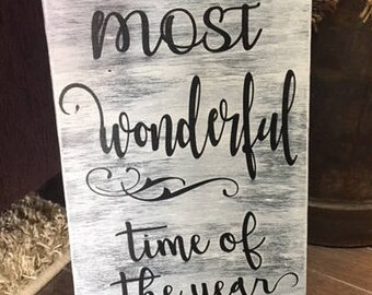 rustic, hand-painted wood sign 'the most wonderful time of the year'