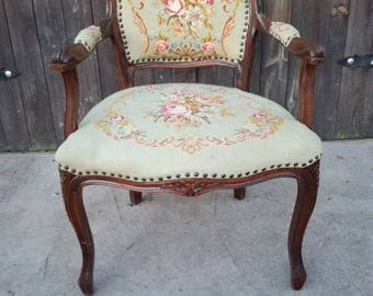 vintage chair with floral embroidery