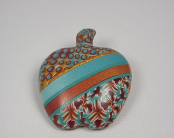 Blue and gold polymer clay Apple brooch
