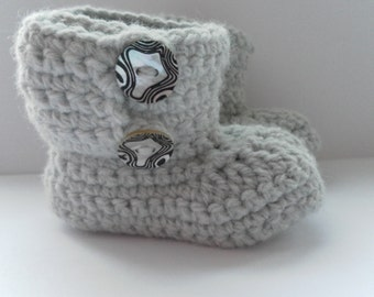 Grey crochet booties for babies, age 0-3 months.