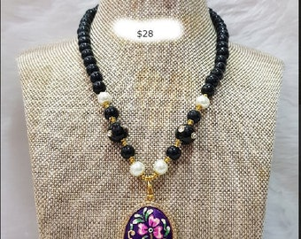 Handmade black beaded necklace with hand-painted pendant