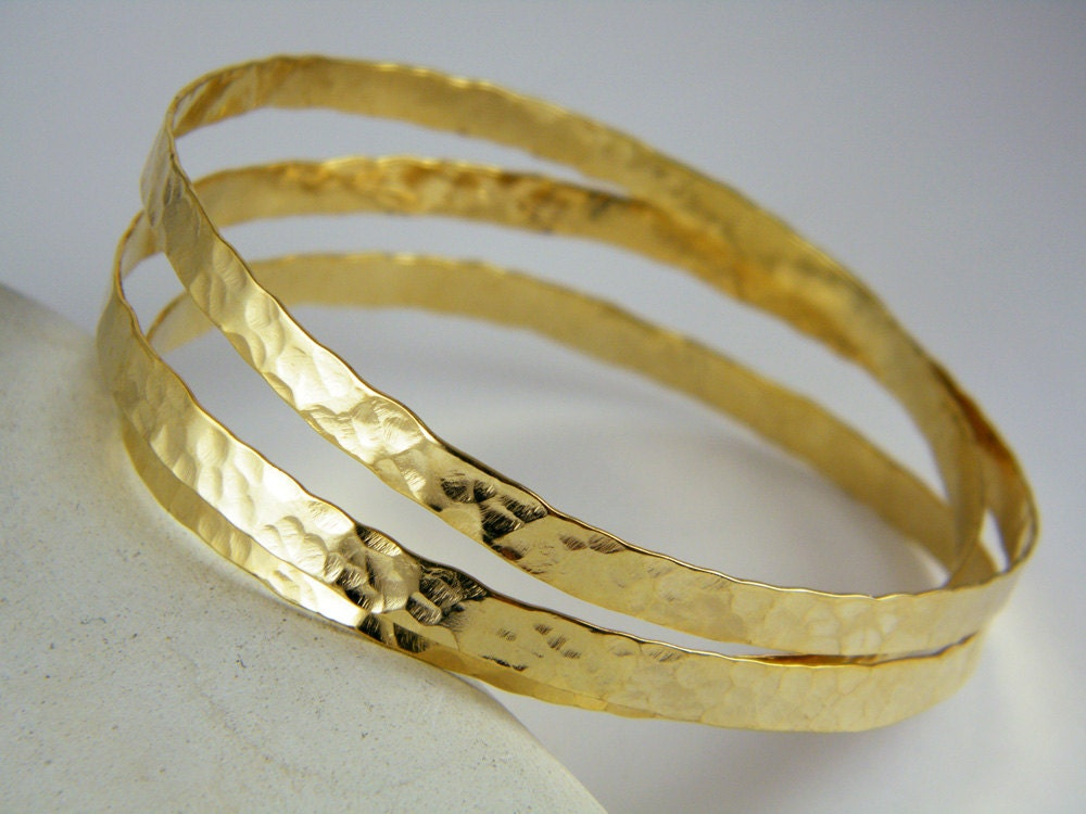 hammered gold and stacking of karma silver bangles textured set