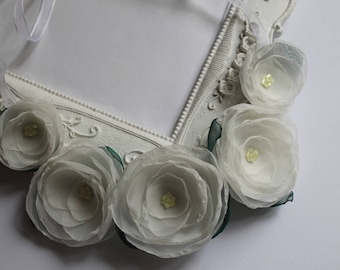 Necklace with five ivory silk flowers