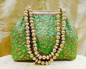 ClutchMart Ethnic wristlet clutch Silk Potli with metal beadwork