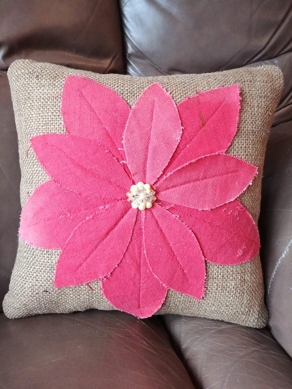small decorative burlap pillow with flower from vintage canvas and buttons