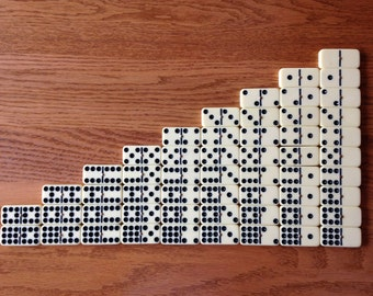 Lot of 54 Cream-colored Dominoes with brass spinners for crafts