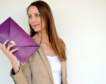 Purple leather clutch with croco pattern