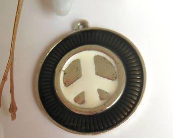 pretty black and silver metal Medallion charm