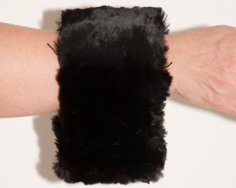Vintage cufflinks with a black fur coat 1940-1960