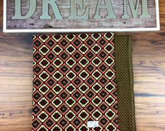 Double sided flannel with brown, tan and red print