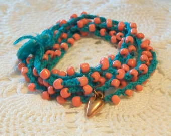 Beaded wrist wrap   Bohemian bracelet   Stacked bracelet   Orange and turquoise, Button closure, Heart charm dangle