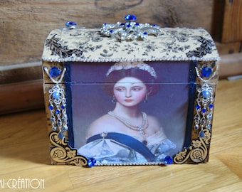 Small chest with black flowers and blue rhinestones