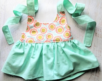 Sunflower coral and mint peplum toddler halter top