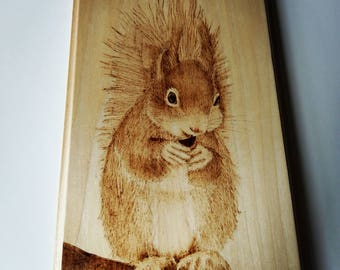 Pyrography wood burning of red squirrel on lime wood