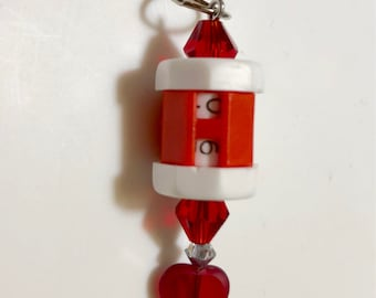 Red beaded row counter with heart beads