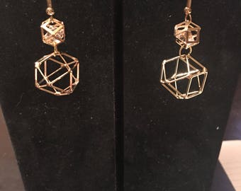 Gold colored earrings