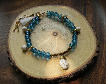 Blue Glass Charm and Tassle Bracelet