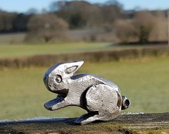 Forged rabbit bottle opener. Blacksmith sculpture.