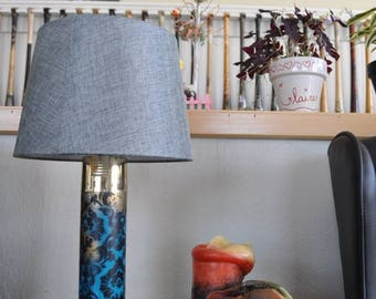 Custom spraycan lamp. Made out of recycled and used spray cans found all over the streets. Turned into functional triple dimmable lamps.