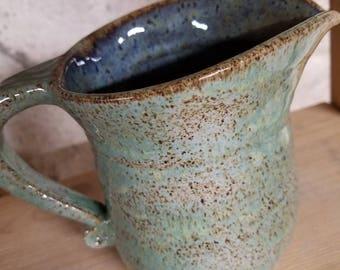 Handmade pitcher or creamer. Aqua and blue wheel thrown pottery.
