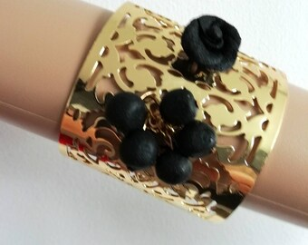 Beautiful Bangle bracelet with flower and fragrant black amber beads.