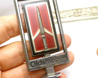 Oldsmobile Rocket Car Red Hood Ornament Chrome Black and Red Used from an Old 1980's vehicle General Motors