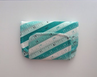 BIG fabric wallet / purse . sewing tape measure tape print with aqua lining .