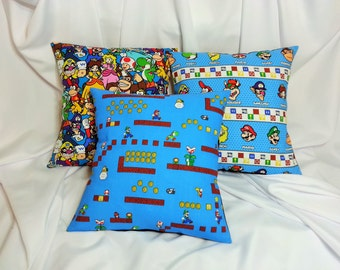 Nintendo Super Mario fabric made into a cotton throw pillow cover for you. Mario, Luigi, Peach, Yoshi, Bowser, & more. Video game bedding,