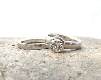 Hearts and arrows wide band engagement ring with matching wedding band, palladium and Forever One moissanite bridal set, low profile bezel