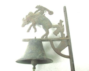 Vintage bell, Cowboy and Horse wall mount bell, dinner bell, farmhouse decor, primitive decor, rustic bell, cast iron bell