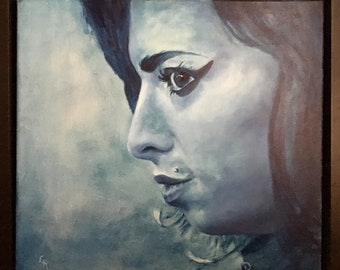 An original Amy Winehouse Oil Painting complete with black frame