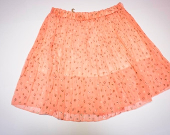 Pink pleated skirt with elastic waist size 42
