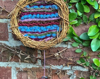 Weaving wall hanging on a branch wreath!
